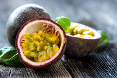 Delicious passion fruit on wooden background. Macro Stock Images