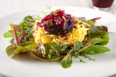 Delicious pasta dish. With blood sausage and small mushrooms Stock Images