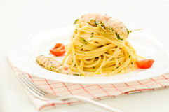 Delicious pasta like spaghetti topped with the sauce of sea mant Stock Image