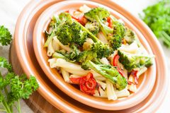 Delicious pasta with pepper and broccoli. Italian food Royalty Free Stock Photo