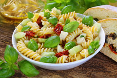 Delicious pasta salad with sun dried tomatoes Royalty Free Stock Image