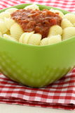 Delicious pasta shells with fresh marinara sauce Stock Images