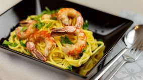 Delicious pasta with shrimps. Taste the delicious pasta made with shrimps and seasoned with fresh parsley Royalty Free Stock Photography