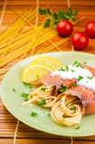 Delicious pasta with somon and tomatoes Stock Image