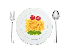 Delicious pasta with tomato and basil on plate isolated on white Stock Photography