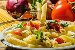Delicious pasta with tomatoes Stock Photo