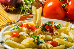 Delicious pasta with tomatoes Stock Photos