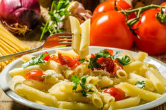 Delicious pasta with tomatoes Stock Images