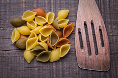 Delicious pasta on wooden texture. Wooden fork. Stock Photography