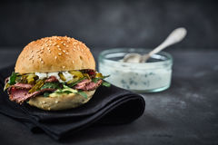 Delicious pastrami burger with mayonnaise Stock Photos