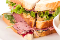 Delicious pastrami club sandwich and pickles Stock Photos