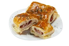 Delicious pastry with ham Stock Images