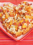 Delicious Peach Cobbler. In a Heart Shaped Plate royalty free stock photography