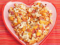 Delicious Peach Cobbler. In a Heart Shaped Plate stock images