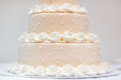 Delicious peach and white wedding cake