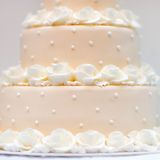 Delicious peach and white wedding cake Stock Photography