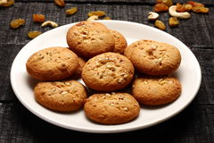 Delicious peanut butter  cookies with nuts and raisins Stock Images
