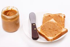 Delicious peanut butter on the table Stock Images