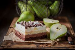 Delicious pear cake with fresh fruits on old wooden box Stock Photos