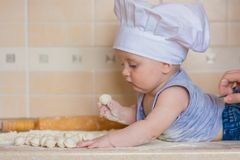 Delicious pelmeni. expensive and tasty. Little cook with a wooden rolling pin stock images