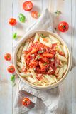 Delicious penne bolognese made of fresh tomatoes Royalty Free Stock Photos