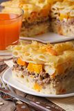 Delicious penne pasta baked with meat and pumpkin close up Stock Photography