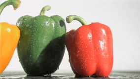 Delicious peppers in super slow motion receiving raindrops stock footage