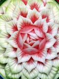 Delicious Petals. Flower petal sculpture in a juicy watermelon stock photos