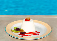 Delicious dessert near swimming pool Stock Image