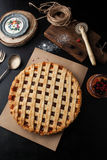 Delicious pie with jam and berries. On a dark background Royalty Free Stock Photos