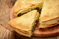 Delicious pie with spinach and feta cheese - spanakopita, traditional greek cuisine. Stock Photo
