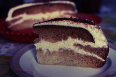 A delicious piece of cake. Cake coffee sponge cake with butter cream Royalty Free Stock Photo