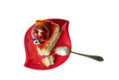 Delicious piece of cake on white background. Delicious piece of cake on red saucer, isolated white background with clipping path Stock Photos