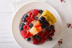 Delicious piece of fruit cake jelly close-up on a plate. Horizon Royalty Free Stock Images