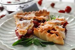 Delicious pieces of cherry pie. On white plate stock photos