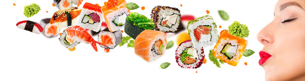Delicious pieces of sushi. Isolated on white background Royalty Free Stock Photos