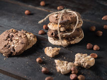 Delicious pile of chocolate chip cookies on dark wooden backgrou Royalty Free Stock Images