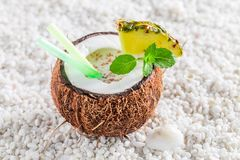 Delicious pinacolada in coconut Royalty Free Stock Images