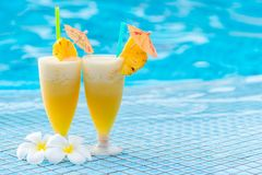 Delicious pineapple cocktail beautifully decorated with umbrella stock photography