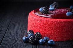 Delicious pink cake with berries on wooden table Stock Photos