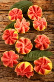 Delicious pink tropical guava fruits slices Stock Images