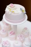 Delicious pink wedding cake and cupcakes Stock Image