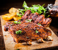 Delicious piquant grilled ribs Royalty Free Stock Images