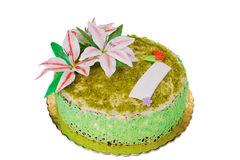 Delicious pistachio cake. With the lily flower Stock Image