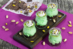 Delicious pistachio Cheesecake Mousse topped with whipped cream, Stock Photography