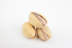 Delicious pistachio nuts on  plate on  white background Stock Photos