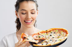 Delicious pizza. Girl eating a delicious pizza Royalty Free Stock Photography