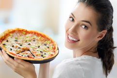Delicious pizza. Girl eating a delicious pizza Stock Image