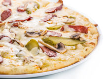 Delicious pizza. With mushrooms, pickled cucumbers and sausages Royalty Free Stock Image