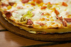 Delicious pizza. Just served on the table Royalty Free Stock Images